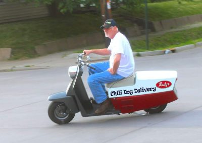 Man riding Rudy's Scooter