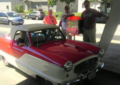 Vintage red and white car at rootbeer stand